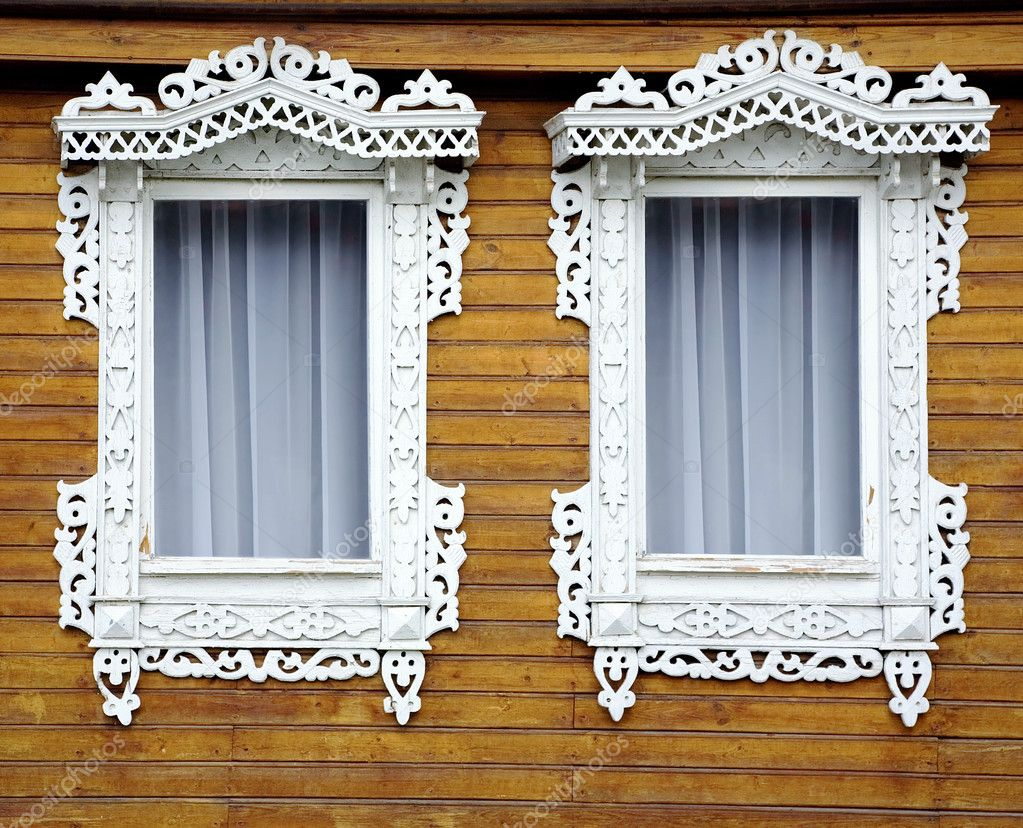 Two windows from old wooden yellow wall of house  Stock Photo #2300720
