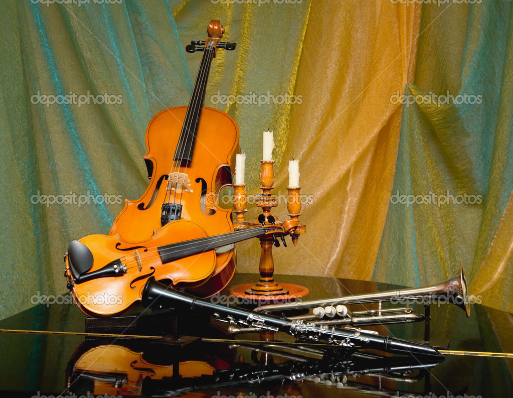 Still-life from a violin and other musical instruments — Stock Photo #2301588