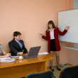Young woman to speak at a meeting — Stock Photo #2310389