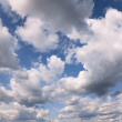 Summer blue sky covered with cumulus clouds — Stock Photo
