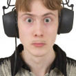 Amusing young man in ear-phones — Stock Photo