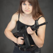 Beautiful young sexual woman - soldier with a ri — Stock Photo #2311851