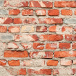 Weathered old grunge red brick wall — Stock Photo