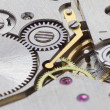 Ancient tiny metal clockwork close up — Stockfoto