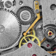 Ancient metal clockwork close up background — Stockfoto