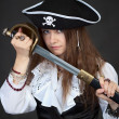 Portrait of woman in pirate hat with sabre in ha — Stock Photo