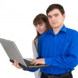 Stock Photo: Young pair with the laptop