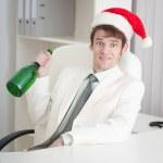 Businessman begins Christmas celebrating at offi — Stock Photo