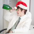 Stock Photo: Businessmcelebrates Christmases at office on