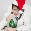 Young man celebrates Christmas at office — Stock Photo