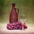 Still-life with clay bottle, glass and grapes ag — Stock Photo