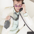 Young businessman speaks on phone, worries and r — Stock Photo #2317237