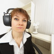 Stock Photo: Comical girl in big stereos ear-phones