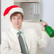 Businessman cheerfully celebrates Christmas at o — Stock Photo #2317963
