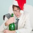 Stock Photo: Drunk and tired guy in white jacket with bottle