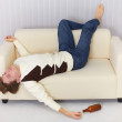 Drunk person funny sleeps on sofa — Stock Photo
