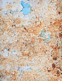 Weathered surface of a steel sheet with paint sc — Stock Photo