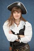 Pirate woman emotionally poses on blue backgroun — Stock Photo