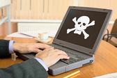 Laptop with pirate software — Stock Photo