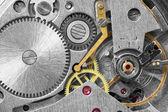 Ancient metal clockwork close up background — Stock Photo