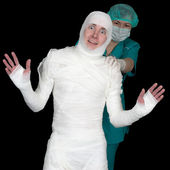 Funny sick in bandage and nurse — Stock Photo
