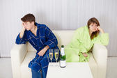 Quarrelled husband and wife at house on sofa — Stock Photo