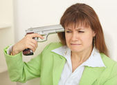 Woman - suicide shoots to itself at head from a — Stock Photo