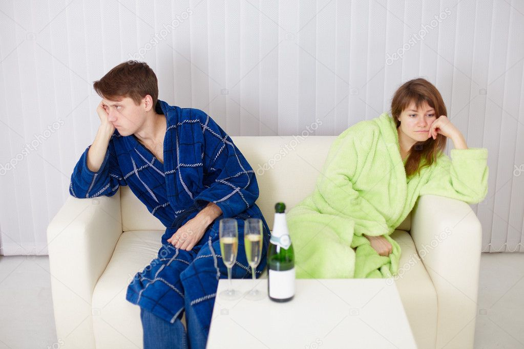 The quarrelled husband and the wife at the house on a sofa — Stock Photo #2316869