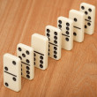 Royalty-Free Stock Photo: Line from seven dominoes on wooden surface
