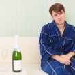 Guy in expectation of woman with sparkling wine — Stock Photo #2322756
