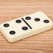 One tile dominoes on wooden surface close up — Stock Photo