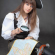 Pirate with sea map, magnifier glass — Stock Photo