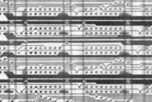 Monochrome industrial circuit board background — Stock Photo