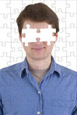 Unknown person with puzzle effect — Stock Photo