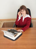 Woman working with old typewriter — Stock Photo