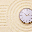 Old watch on sand in composition of Japanese roc — Stock Photo