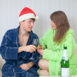 Young couple drinks sparkling wine in dressing g — Stock Photo