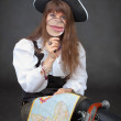 Woman - captain of sea pirates with map and magn — Stock Photo