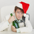 Stock Photo: Young drunkard celebrates new year at office