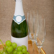 Sparkling wine with grapes, glasses - Stock Photo