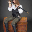 Woman pirate gets sabre from a sheath — Stock Photo