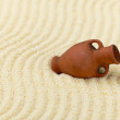 Ancient clay amphora on surface of sand — Stock Photo