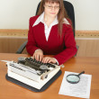 Serious woman secretary printing text — Stock Photo