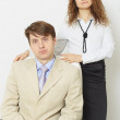 Serious man in jacket and tie and woman — Stock Photo