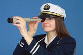 Portrait of girl - captain with spyglass — Stock Photo