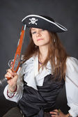 Portrait of beautiful girl in pirate hat with pi — Stock Photo