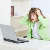 Person in shock working in Internet with the lap — Stock Photo