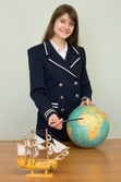 Woman in sea uniform with globe — Stock Photo