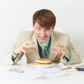 Person is going to eat on workplace — Stock Photo
