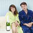 Young happy couple in dressing gowns — Stock Photo